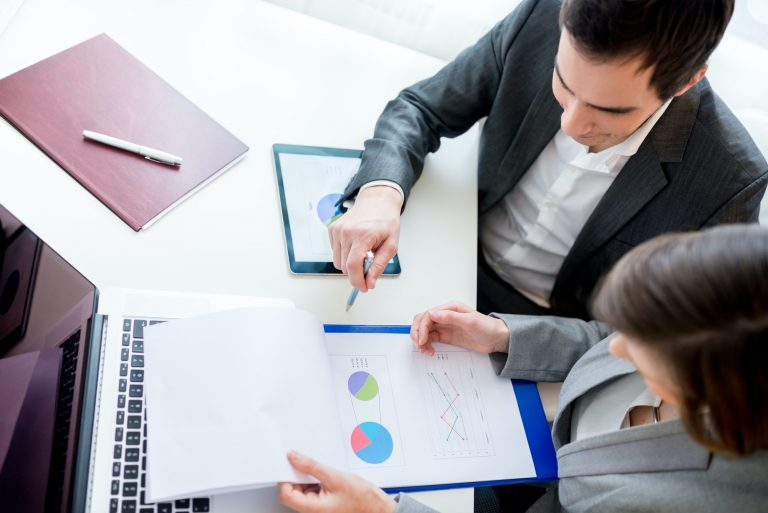 Business People Reviewing Business Documents